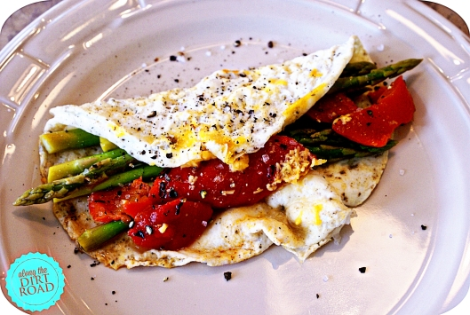 One example of being good.  Egg white omelet with roasted red peppers, left-over asparagus, turkey pepperoni and a sprinkle of cheese.  YUM!