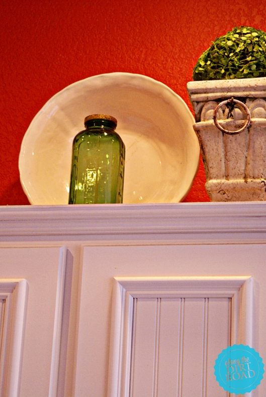 This little green juice and water jar was given to me by a friend at Christmas.  I love it.  The white piece of ceramic behind...was free at an antique mall booth.  It has a crack in it...but well loved things are welcome in our home.
